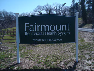 Carved sign for Fairmount Institute